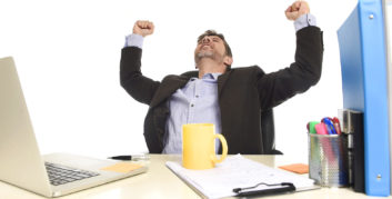 Man celebrating who was able to attract his dream company.