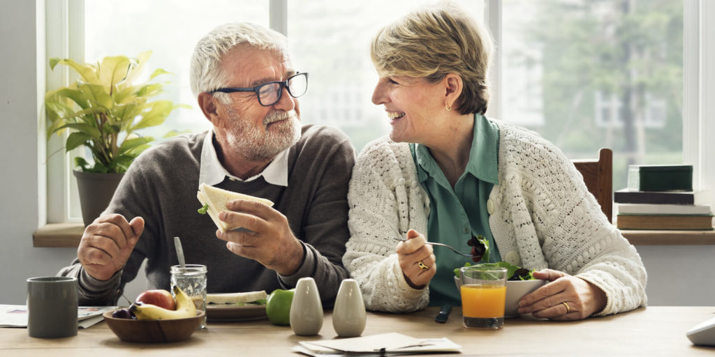 Retired couple talking about the benefits of flexible work for retirees