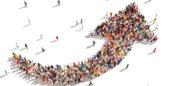 Large group of people form the shape on an upward arrow.