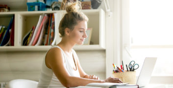 Young woman sitting at her computer in her home office