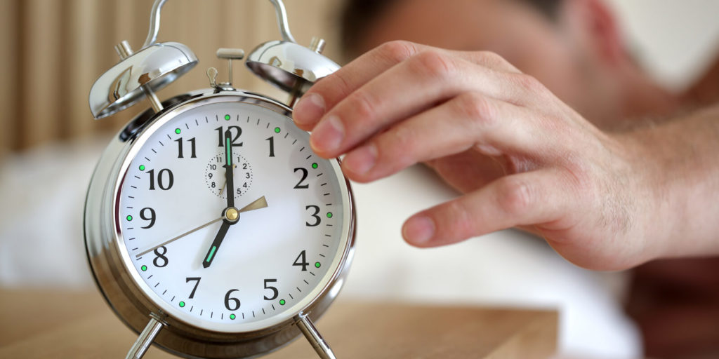 Man scheduling an extra hour to think and plan to improve your business.