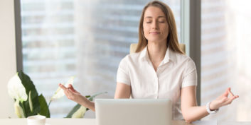 Woman using meditation to boost job searching