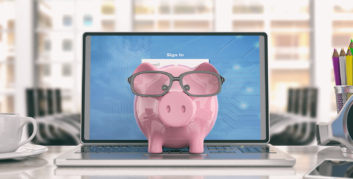 Piggy bank on laptop for a six-figure income with a work-from-anywhere job.