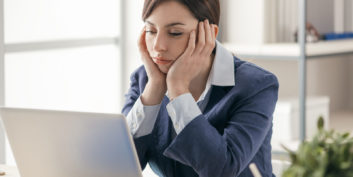Woman wondering how to stay motivated at work.