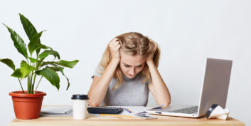 Woman trying to handle workplace stressors