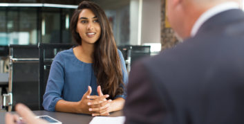 Woman using questions to ask in a second interview