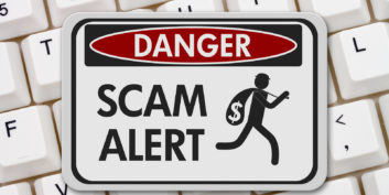 Scam alert sign for common job search scams