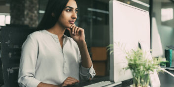 Woman looking at flexible management jobs