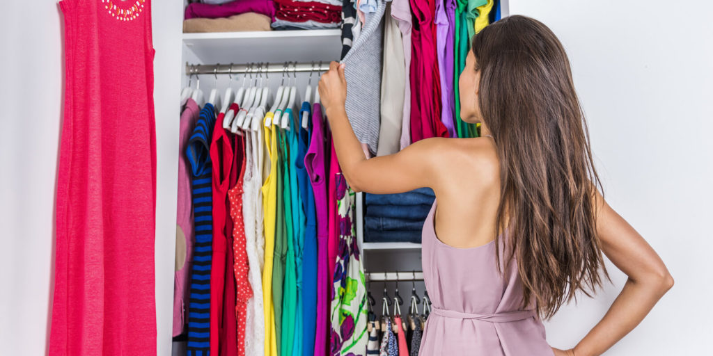 Woman choosing her remote work wardrobe.