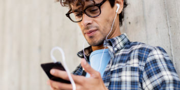 Man listening to podcasts for job seekers