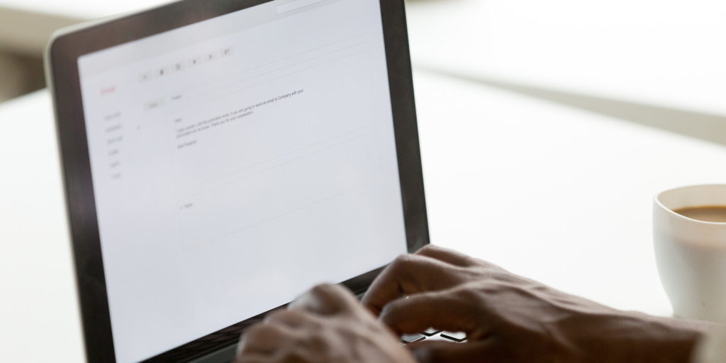 Man wondering how to start an email