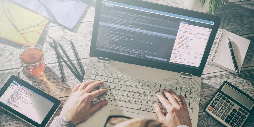 Man working at remote software developer jobs