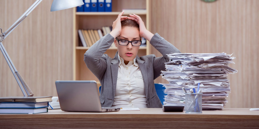 Woman trying to manage a heavy workload