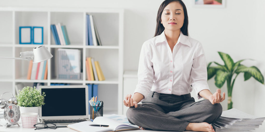 Woman trying to practice mindfulness at work