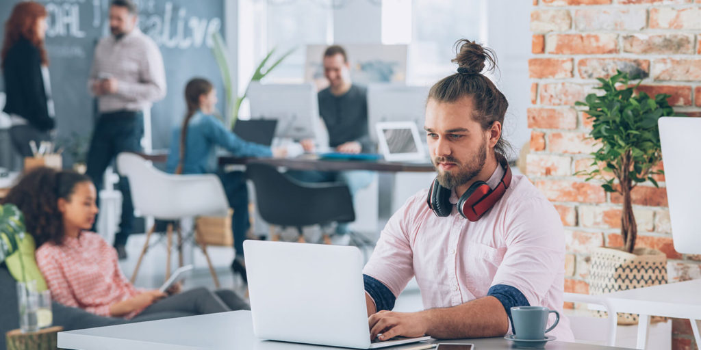 man experiencing the pros and cons of coworking