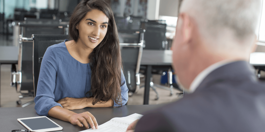 Woman trying to ask for work flexibility during her annual review