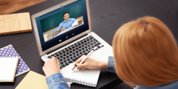 Woman checking out remote entry-level teaching jobs