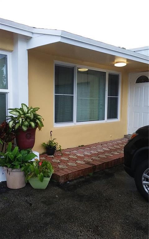 9530 N Sunset Strip, Sunrise, FL 33322