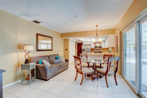 OPEN CONCEPT KITCHEN SITTING AREA: HERES YOUR CHANCE TO OWN A WELL APPOINTED 3 BR/ 2 BA/ 1 CAR / POOL HOME IN CORAL HEIGHTS. FEATURES TRUE SPLIT FLOOR PLAN FOR ALL 3 BEDROOMS. KITCHEN HAS STAINLESS STEEL APPLIANCES, SEPARATE LAUNDRY ROOM, LOTS OF STORAGE WITH BONUS ROOM, 95% IMPACT GLASS, PAVERED CIRCUAR DRIVEWAY, SCREENED IN PATIO AREAS FOR OUTDOOR ENTERTAINING, HEATED POOL W/ EASY ACCESS TO US1, I-95 AND 5-10 MIN DRIVE TO THE BEACHES, GALLERIA MALL, SHOPS, RESTAURANTS, MOVIES, 6+ GROCERY STORES AND MORE!