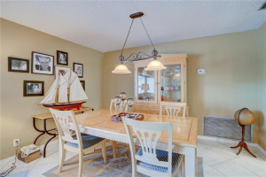 DINING AREA: HERES YOUR CHANCE TO OWN A WELL APPOINTED 3 BR/ 2 BA/ 1 CAR / POOL HOME IN CORAL HEIGHTS. FEATURES TRUE SPLIT FLOOR PLAN FOR ALL 3 BEDROOMS. KITCHEN HAS STAINLESS STEEL APPLIANCES, SEPARATE LAUNDRY ROOM, LOTS OF STORAGE WITH BONUS ROOM, 95% IMPACT GLASS, PAVERED CIRCUAR DRIVEWAY, SCREENED IN PATIO AREAS FOR OUTDOOR ENTERTAINING, HEATED POOL W/ WATERFALL. EASY ACCESS TO US1, I-95 AND 5-10 MIN DRIVE TO THE BEACHES, GALLERIA MALL, SHOPS, RESTAURANTS, MOVIES, 6+ GROCERY STORES AND MORE!..