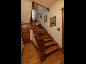 Open staircase to upper level, Main floor 1/2 bath through door