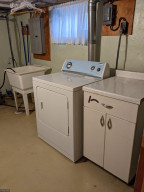 Lower level laundry with plenty of room for storage