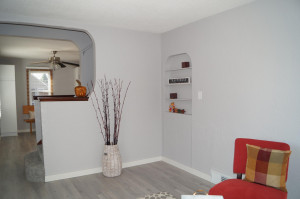 Living room with open stairwell, new flooring throughout property