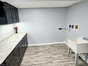 What a laundry room! Lots of countertop space to fold.