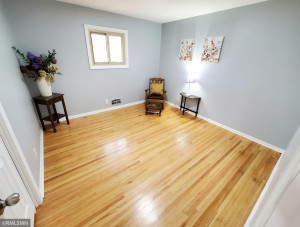 Two of the 3 mainfloor bedrooms have gleaming refinished hardwood floors