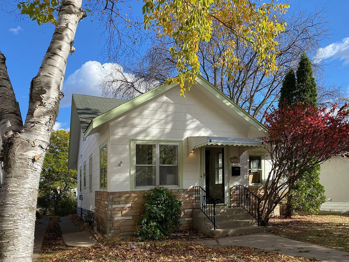 Classic, south Minneapolis bungalow with stone detail on the front. Freshly painted inside and out.