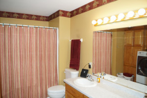 Additional main floor bath with laundry room