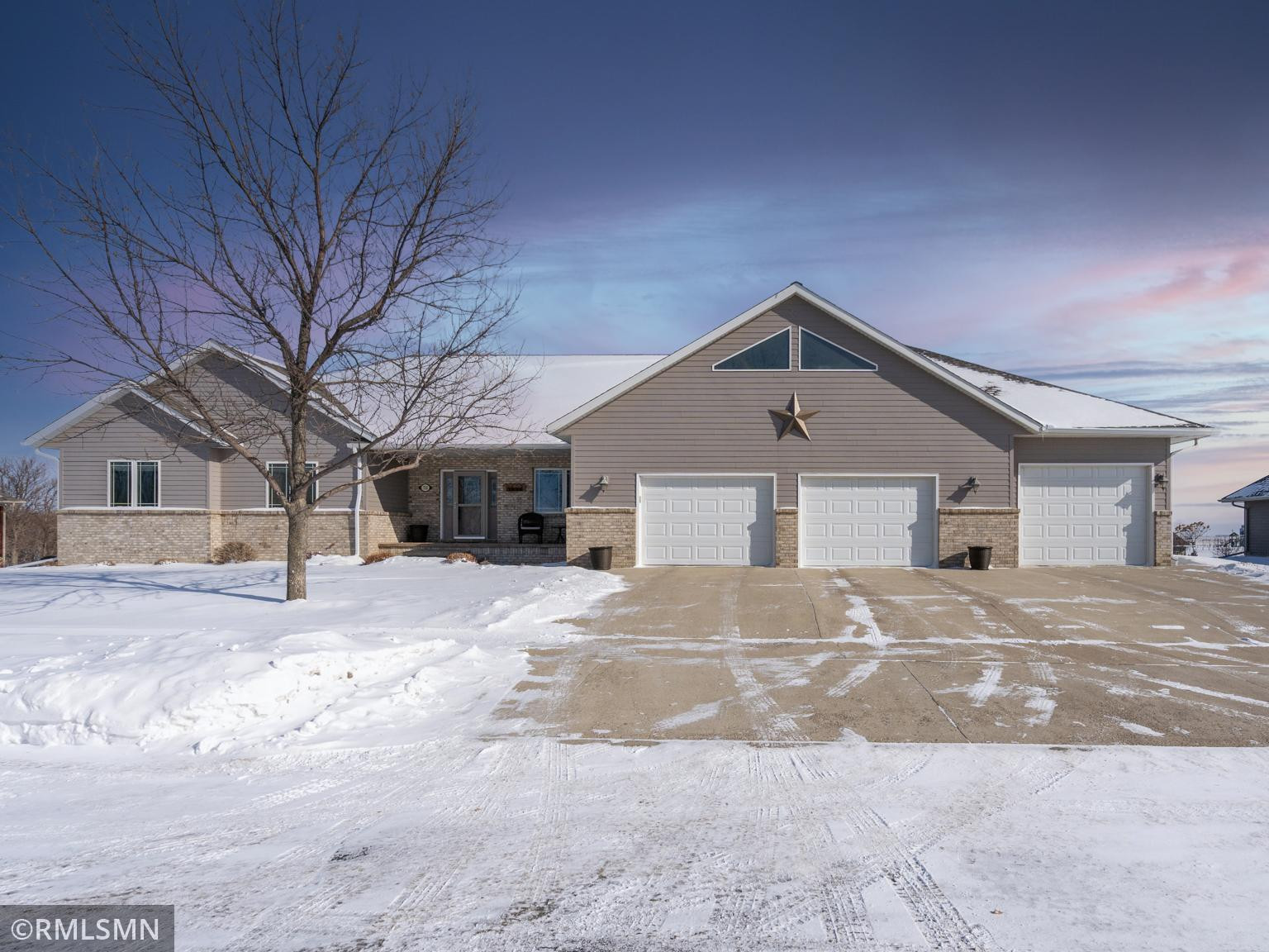 WOW! A three stall garage PLUS bonus room AND extra storage space on top!