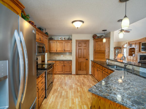 In addition to the new granite countertops, tile backsplash & stainless steel appliances - you will LOVE the walk in pantry & central vacuum system!