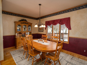 Informal dining room overlooks back deck & yard and is open to living and kitchen for gracious open concept flow on main level.
