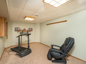 This workout area is in addition to family room, billiards and full-wall shelved game/storage closet.