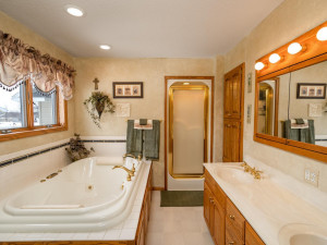 Ensuite bath features double sinks, jetted tub and separate shower.