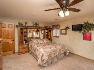 Expansive main floor bedroom boasts sliding door to large back deck and sitting area.