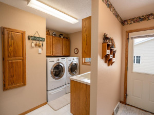 Laundry room is an understatement! Side entry boasts spacious coat closet and dual access to garage entry, as well.