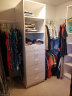 How will you organize your belongings in this bedroom closet?