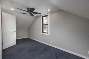 Upstairs bedroom, updated windows, walls, electrical, flooring