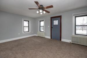 Living room, New carpet, updated windows, new ceiling fan