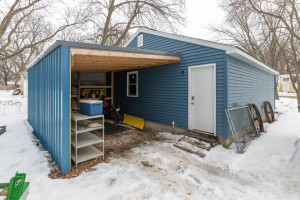 24 wide x 28 deep newly sided garage with separate driveway, plus lean-to area