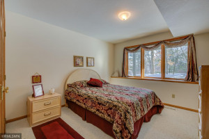 Lower level bedroom with look out windows.