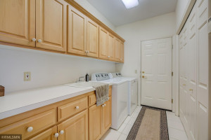Main-Level Laundry Room with Maple Cabinets and Large Closet