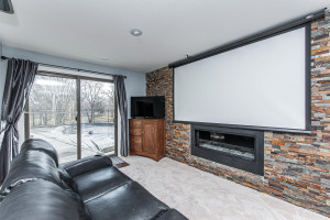 Decorative fireplace with walkout to patio/pool