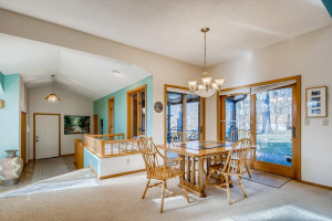 Large, attached dining space with quick access to the yard and screened in porch.
