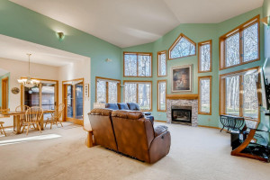 Gather with your family in front of the gas fireplace with an amazing view.