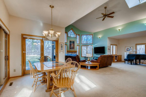 The combined dining and living room is incredibly open and surrounded by windows.