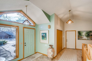 Bright entry with easy access to the attached 3 car garage.
