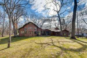 A view of this beautiful home from the back of the .55 acre lot.